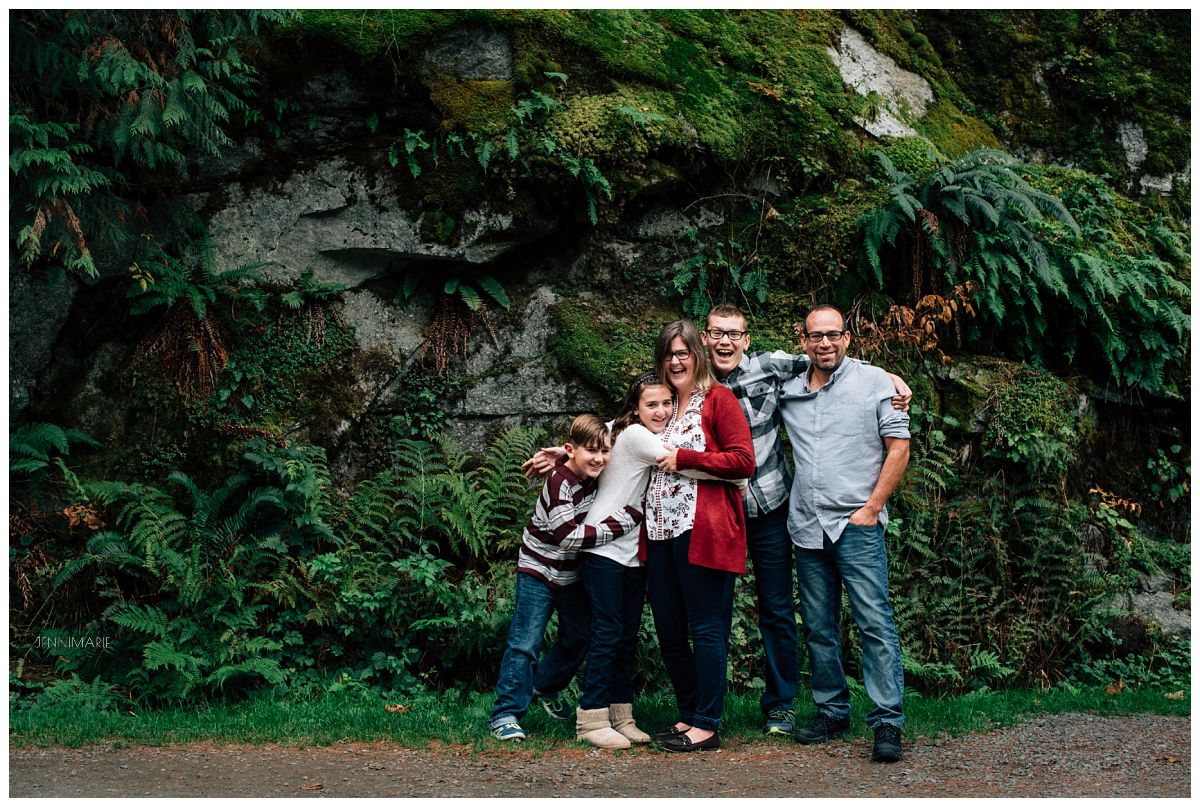 """With hues of red and gray, this family is unified in aesthetic but everyone still looks like """"them""""."""